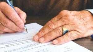 Older hands signing trust