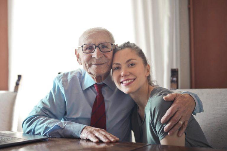 A caregiver and receiver share a joyful moment.