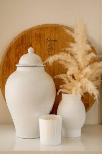 Cremation remains in white urn