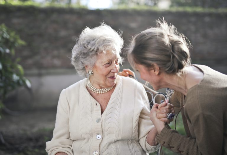 Home care agency caregiver with elderly woman