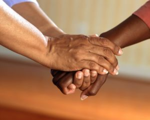 Death doula hands with caregiver