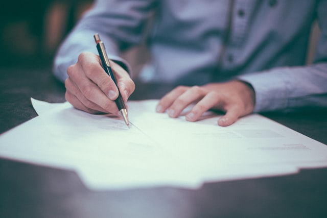 Lawyer writing trust document