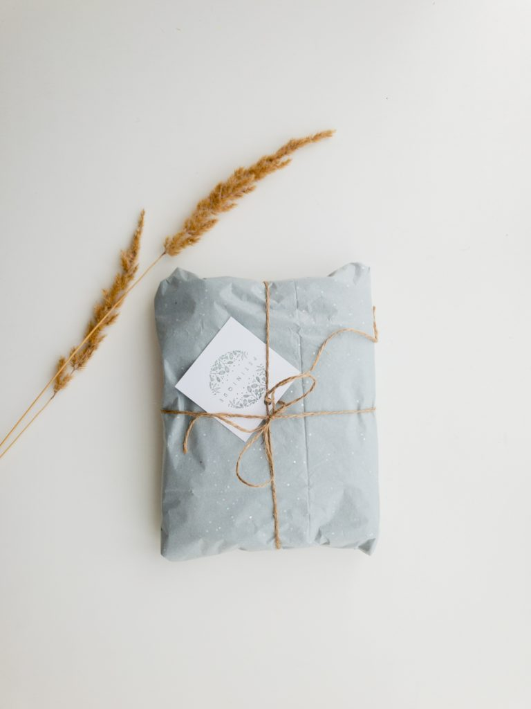 A wrapped gift for caregivers, with a blue and wheat color scheme