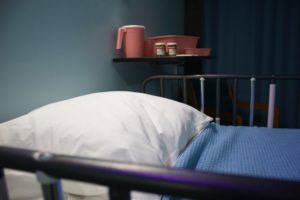 an empty hospital bed like the one you may see after someone dies