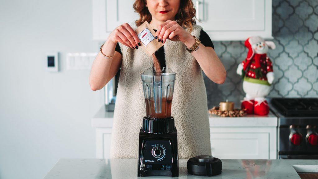 A woman prepares a liquid meal