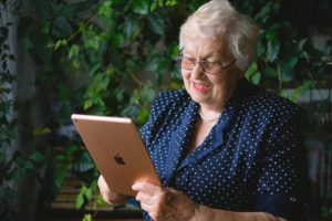 A senior woman looks at her options on an ipad