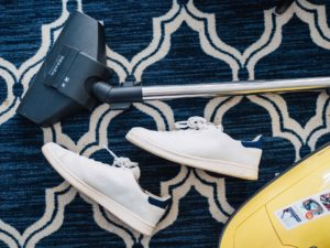 A lightweight vacuum lies on the floor