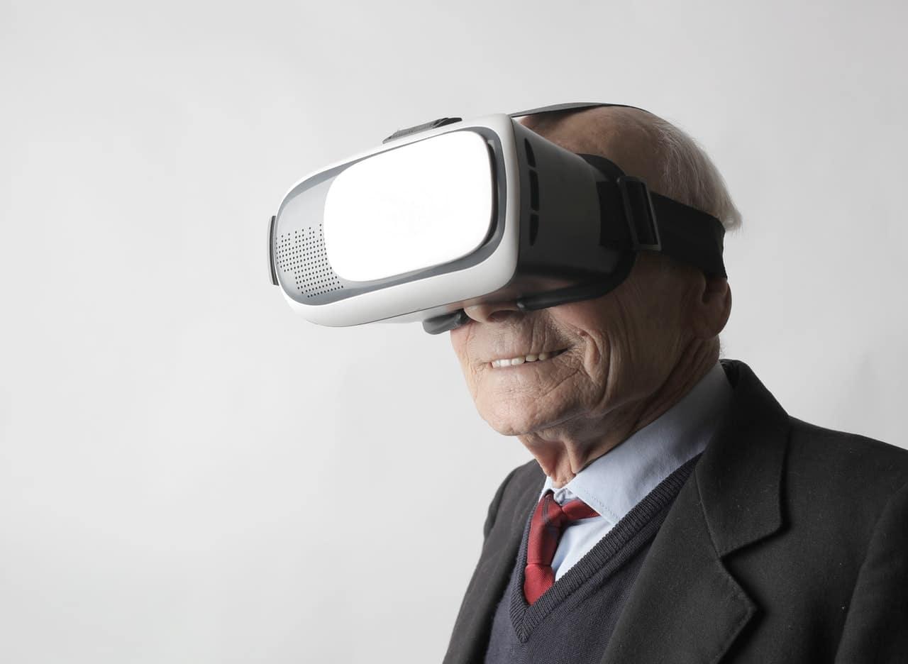 A senior uses virtual reality glasses