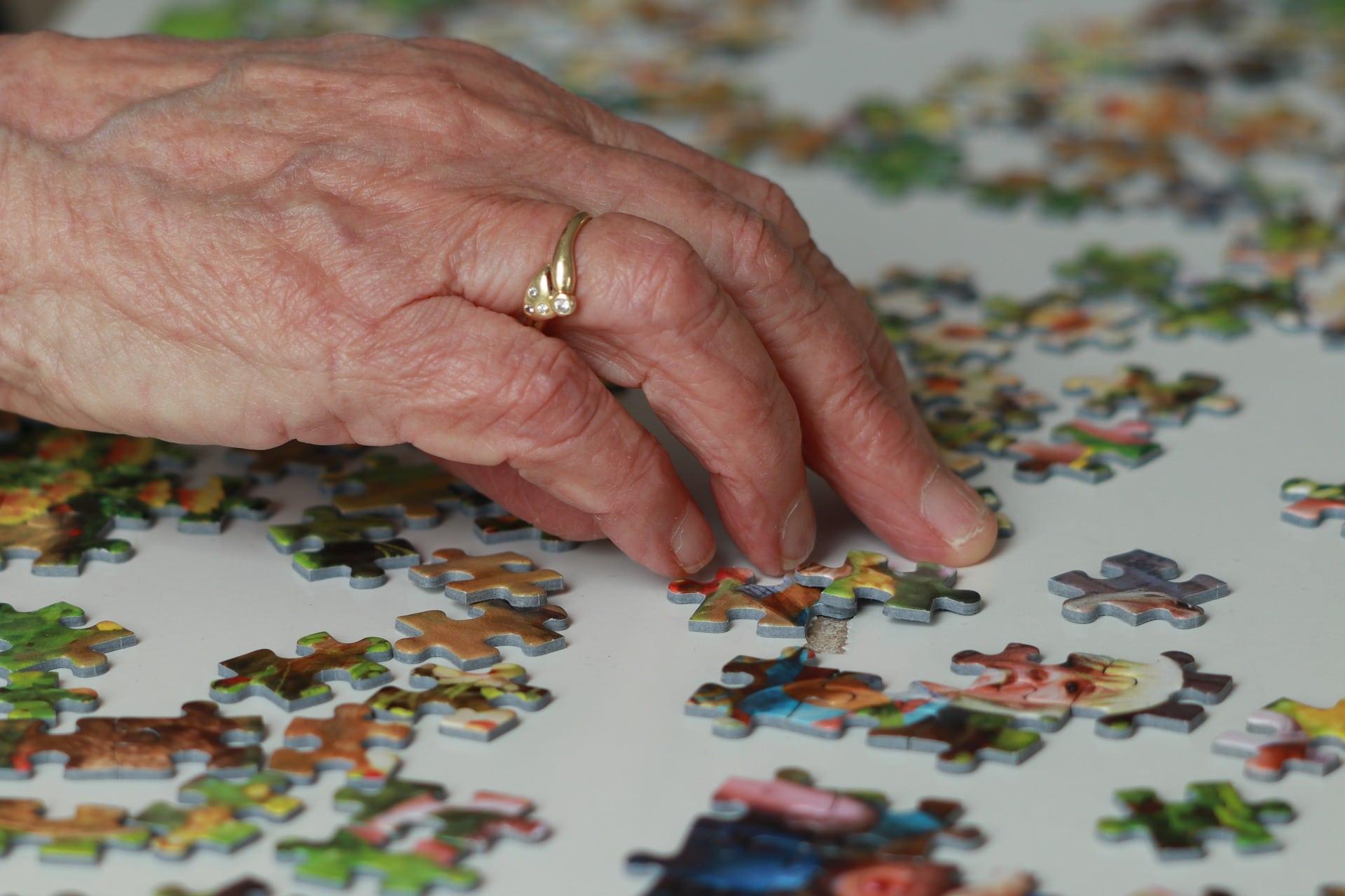 A senior enjoys a jigsaw puzzle