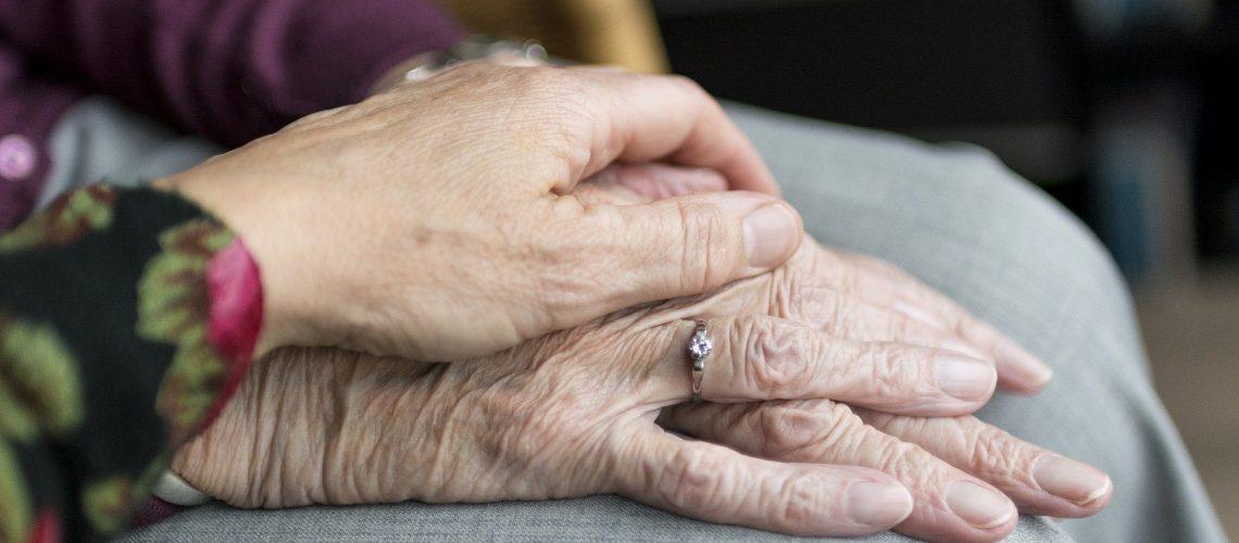 A caregiver comforts a terminally ill person