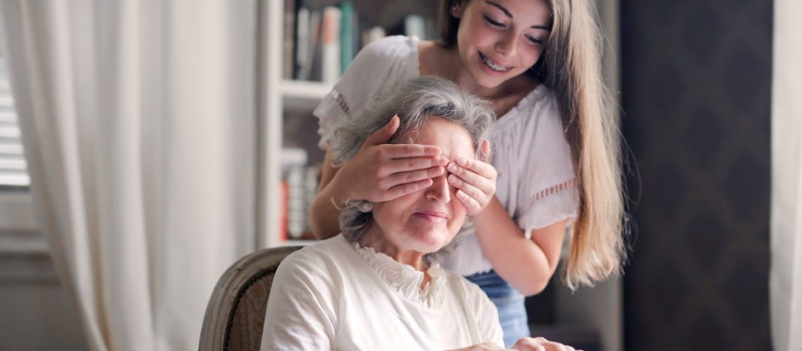 A senior woman spends time with her granddaughter