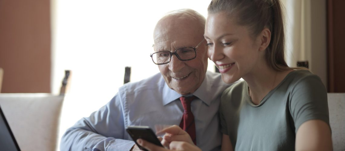 A senior checks out his new cell phone plan