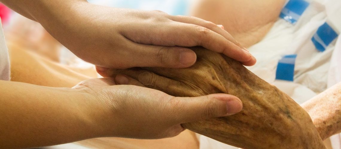 Holding hands during hospice care