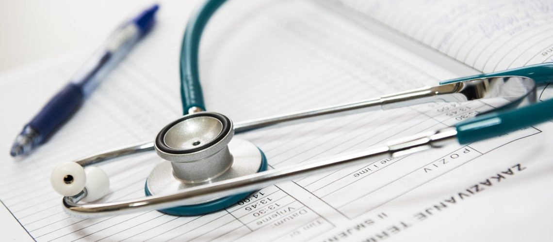 An insurance policy with stethoscope