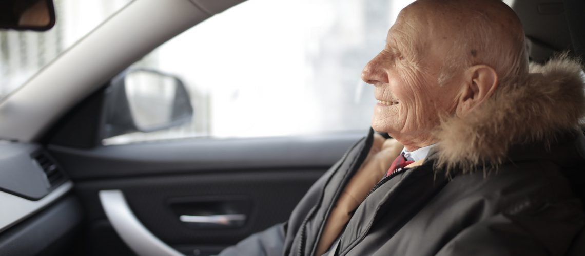 A grandfather takes an Uber ride