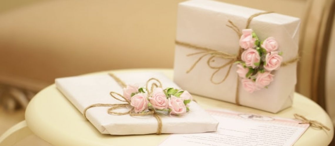 Two gifts for people with dementia, wrapped with pink roses