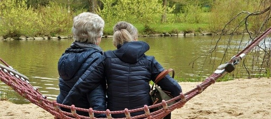 Comforting elderly loved one with dementia on hammock